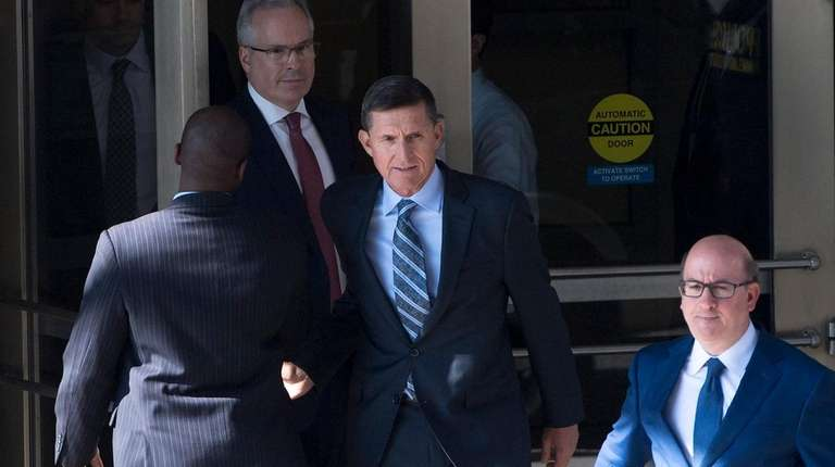 Retired Lt. Gen. Michael Flynn, center, a former