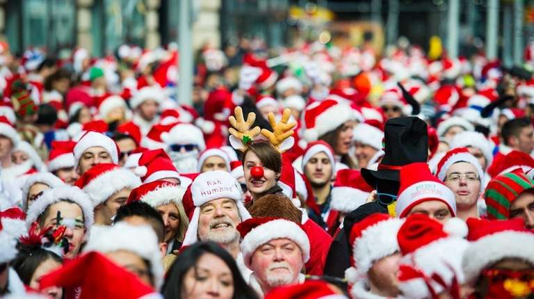 People dressed as Santa Claus and other Christmas