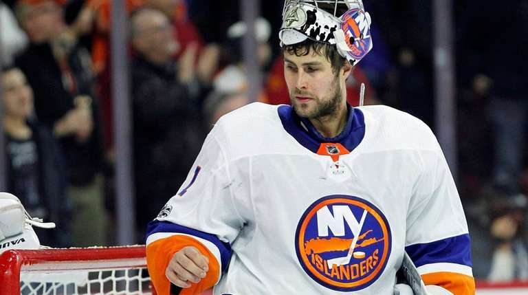 Islanders goalie Thomas Greiss pauses after giving up two