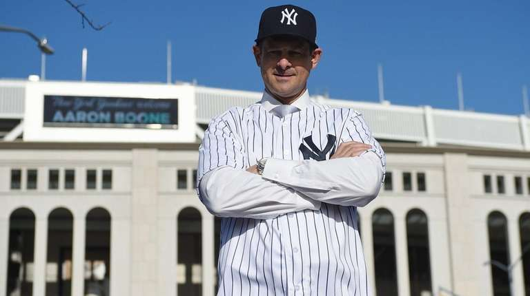 Yankees manager Aaron Boone stands outside Yankee Stadium