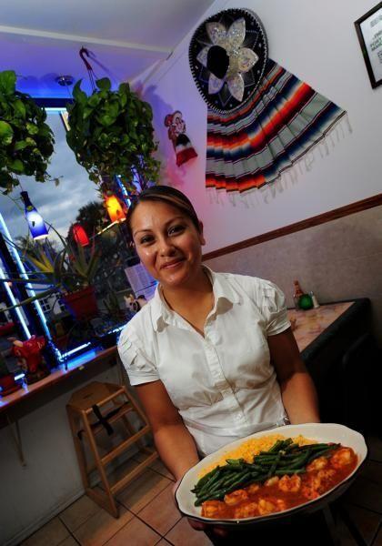 Yeni Ramirez serves camarones al ajillo at El