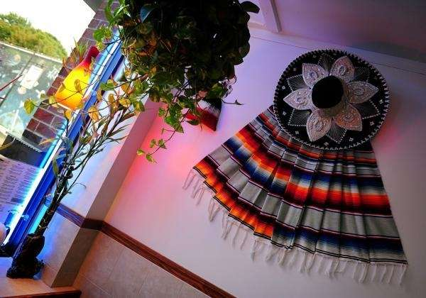 Serapes and sombreros decorate the walls at El