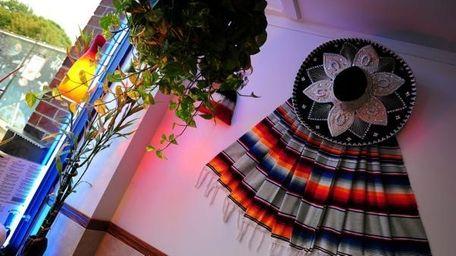 Serapes and sombreros decorate the walls at El