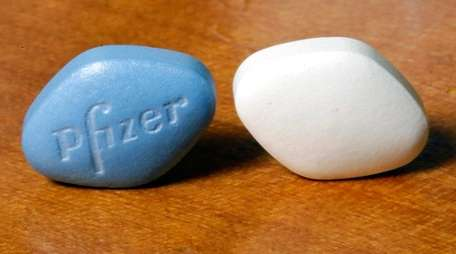A tablet of Pfizer's Viagra, left, and the
