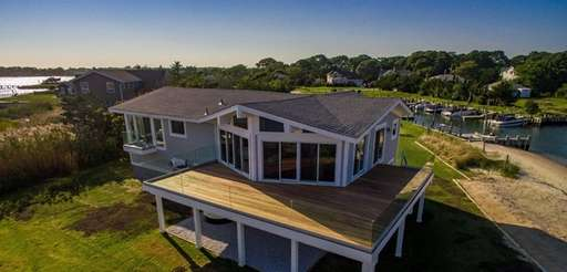 The Hampton Bays home offers waterfront views on
