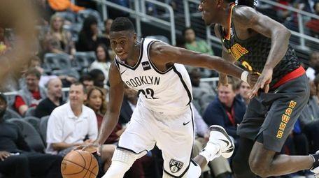 Brooklyn Nets guard Caris LeVert (22) drives against