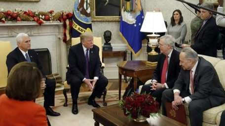 President Donald Trump accompanied by Vice President Mike