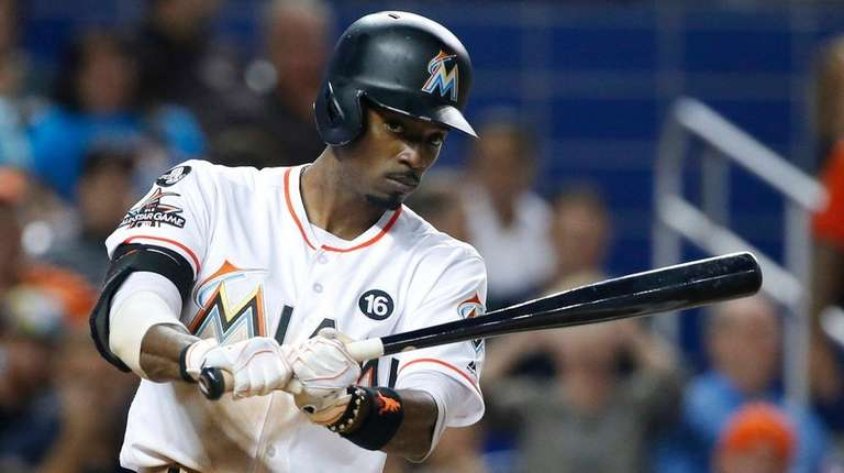 Dee Gordon practices his swing before batting during
