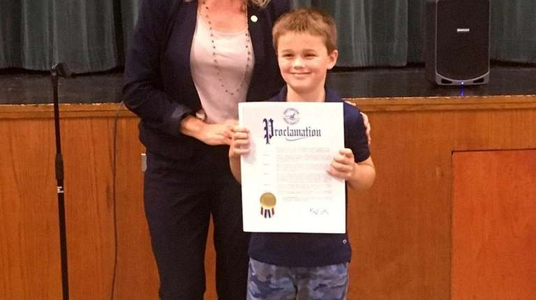Max Atkinson received a proclamation from Suffolk County