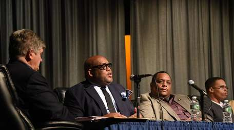 From left, Hempstead school board trustees David Gates,