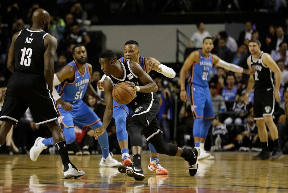 Brooklyn Nets' Caris Levert moves the ball across