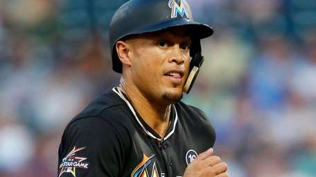Giancarlo Stanton #27 of the Miami Marlins runs