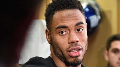 Rashad Jennings answers questions in the Giants' locker