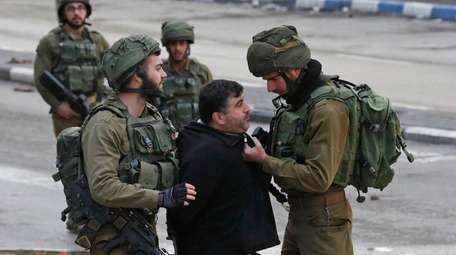 Israeli forces in the West Bank detain