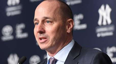 Yankees general manager Brian Cashman speaks during