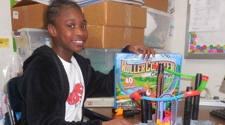 Kidsday reporter Imani Brown-Edwards tests the ThinkFun Roller