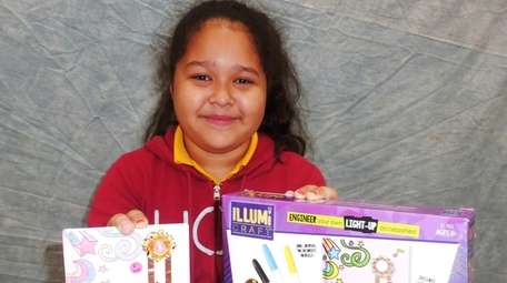 Kidsday reporter Ariadna Mejia tested the Light-Up Journal,