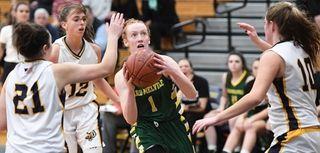 Ward Melville guard Lauren Hansen puts up a