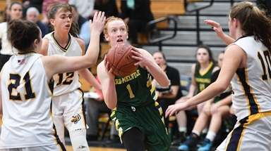 Ward Melville guard Lauren Hansen puts up a