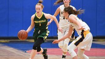 Ward Melville guard Lauren Hansen drives the ball
