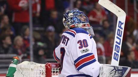 Rangers goalie Henrik Lundqvist looks on after allowing