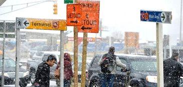 Travellers depart Terminal D at LaGuardia Airport in