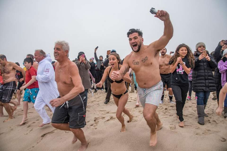 People run towards the water at the annual