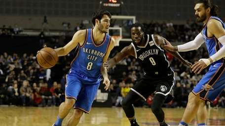 Oklahoma City Thunder's Alex Abrines, left, dribbles past