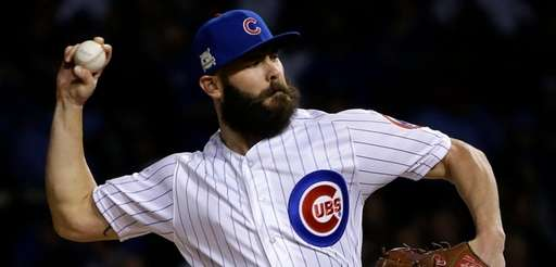 Cubs starting pitcher Jake Arrieta delivers a pitch