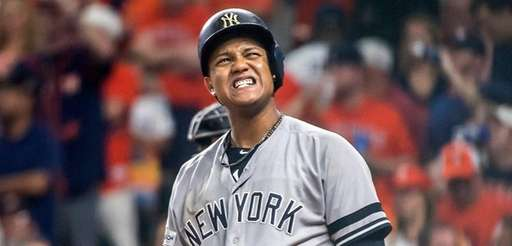 New York Yankees' Starlin Castro reacts after swing