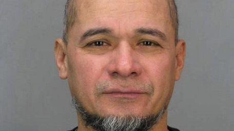 Rudit Santos, 50, of Westbury, was arrested Friday,