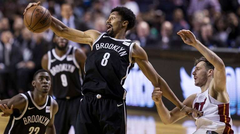 The Nets' Spencer Dinwiddie jumps for the ball