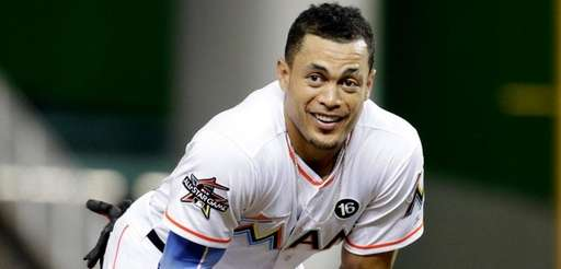 Giancarlo Stanton stands on the field during a
