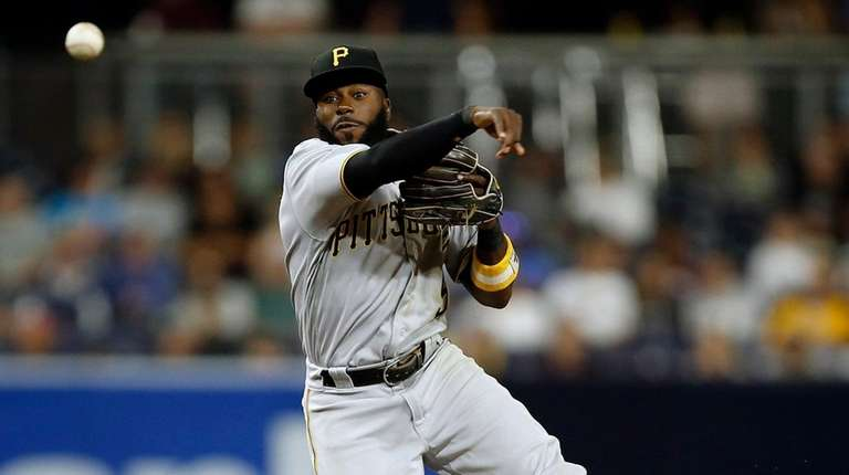 Pittsburgh Pirates second baseman Josh Harrison, above, forces
