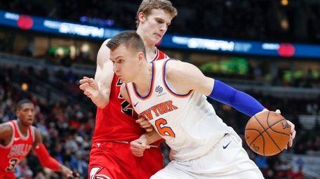 Knicks forward Kristaps Porzingis drives to the basket