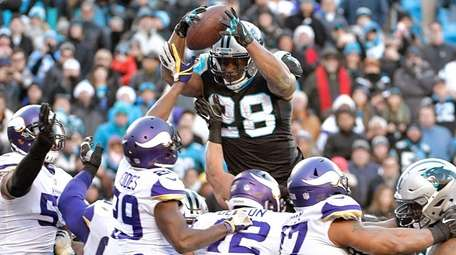 Jonathan Stewart of the Panthers leaps into the