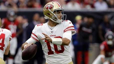49ers quarterback Jimmy Garoppolo throws against the Houston