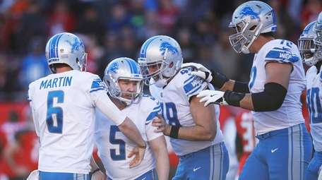 Matt Prater of the Lions celebrates with teammates