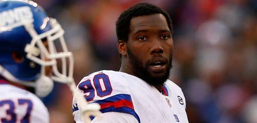 Jason Pierre-Paul of the Giants looks on in