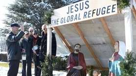 Parishioners helped dedicate a nativity scene and crèche