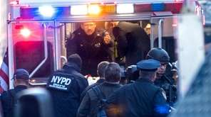 NYPD and FDNY officials place a person into