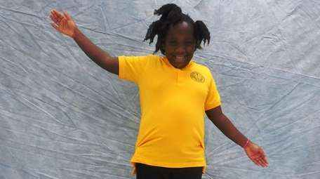 Kidsday reporter Shana Daleus rides a Kryptonics skateboard.