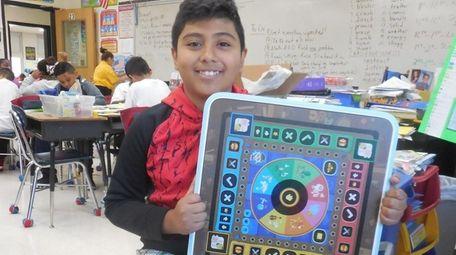 Kidsday reporter Daniel Trejo-Ramirez with the Beyond Tablet