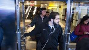 Port Authority Police watch as people evacuate after