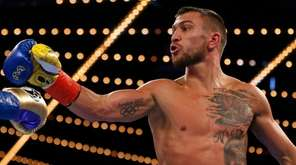 Vasyl Lomachenko, of Ukraine, reacts toward Guillermo Rigondeaux