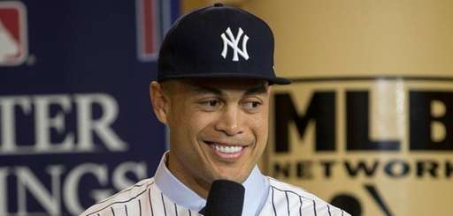 New Yankee Giancarlo Stanton answers questions during a