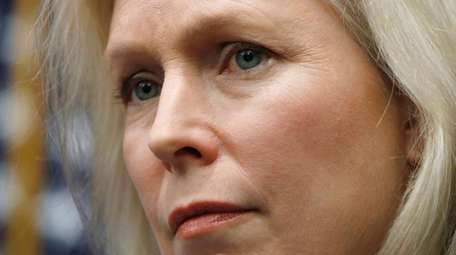 Sen. Kirsten Gillibrand, D-N.Y., listens during a news