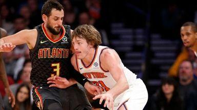 Knicks guard Ron Baker drives toward the basket