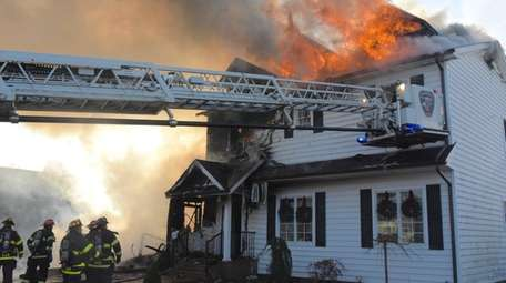 Two homes caught fire in Massapequa on Monday