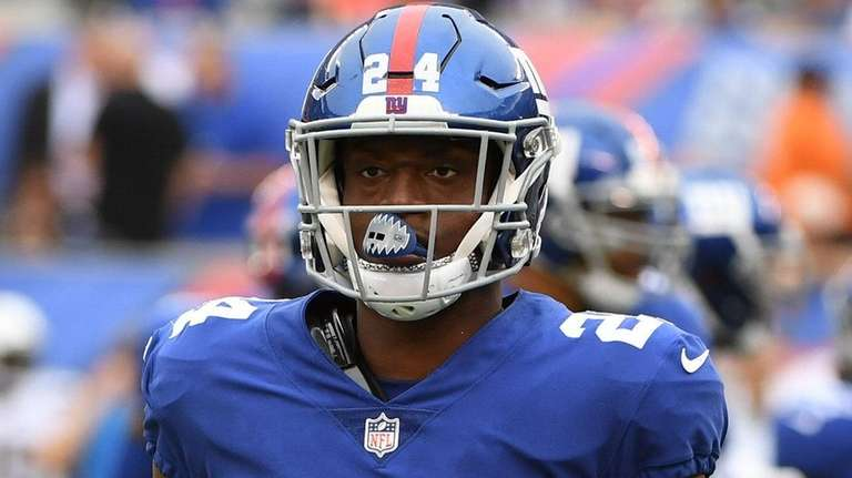 Giants cornerback Eli Apple looks on from the